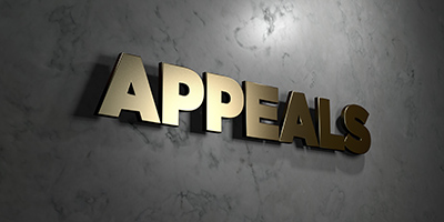 Appeals wall sign - metal on stone